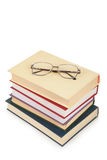 Glasses on pile of book Stock Photo