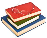 Glasses on a pile of books. Isolated on white background Royalty Free Stock Photo