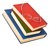 Glasses on a pile of books Royalty Free Stock Image