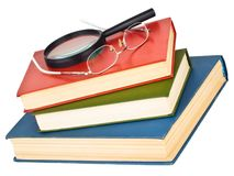 Glasses on a pile of books Royalty Free Stock Images