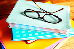 Glasses on a pile of books Stock Photo