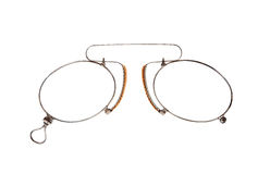 Glasses (pince-nez) on white. Royalty Free Stock Image