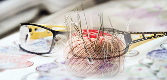 Glasses and pincushion Royalty Free Stock Photography