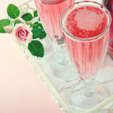 Glasses of pink champagne with a rose Stock Image
