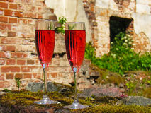 Glasses of pink champagne. On the ruins of the manor Royalty Free Stock Images
