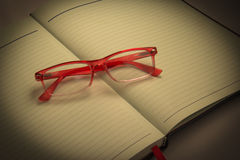 Glasses placed on notebook Royalty Free Stock Photography