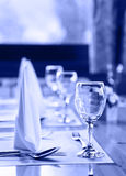 Glasses and plates on table in restaurant Royalty Free Stock Photography