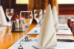 Glasses and plates on table in restaurant Royalty Free Stock Images
