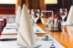 Glasses and plates on table in restaurant Stock Images