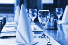Glasses and plates on table in restaurant Stock Photos
