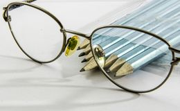 Glasses, with plenty drawing pencils Stock Images