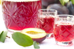 Glasses of plum alcohol and fresh plums Stock Photo