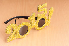 Glasses on plywood background Royalty Free Stock Photos