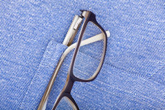 Glasses in pocket. Glasses in the blue shirt pocket Royalty Free Stock Image