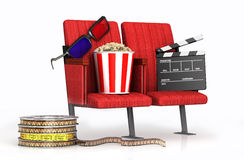 Glasses, ppcorn, clapper on cinems chairs Royalty Free Stock Image