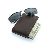Glasses and purse with money Royalty Free Stock Photos