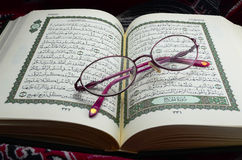 Glasses on Quran. A Glasses on holy muslim book (Quran stock image