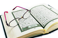Glasses on Quran. A Glasses on holy muslim book (Quran royalty free stock photo