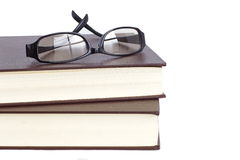 Glasses and reading book Stock Photos
