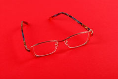 The glasses on red Royalty Free Stock Photo