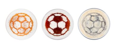 Glasses of red ale stout and lager beer football. Glasses of red ale stout and lager beer top with football shape on white background top view royalty free stock images