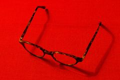Glasses on a red background Royalty Free Stock Photos