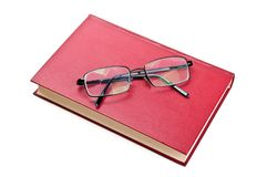 Glasses and red book Royalty Free Stock Photography