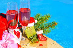 Glasses with red champagne  and Christmas decor Stock Images