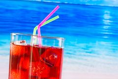 Glasses of red cocktail with straw and space for text Royalty Free Stock Photos