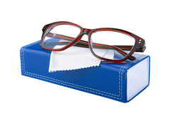 Glasses in the red frame on the blue box Royalty Free Stock Image