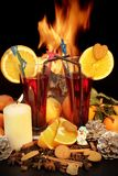 Glasses of red mulled wine and flames in background Royalty Free Stock Photography