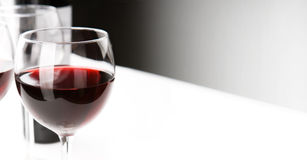 Glasses of red whine on white table cloth. Stock Photo