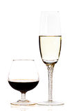 Glasses of red and white wine. On a white background with reflections royalty free stock photography