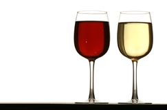 Glasses of red and white wine. Glasses of white wine and red wine standing on table Royalty Free Stock Images