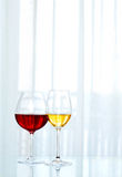 Glasses with red and white wine Stock Images