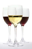 Glasses of red and white wine. Isolated on white stock images