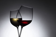 Glasses with red and white wine. Closeup of glasses with red and white wine, free space for your text royalty free stock photo