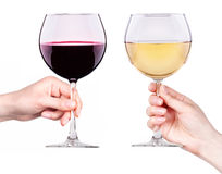 Glasses of red and white wine in hand isolated Stock Image