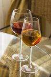 Glasses of red and white wine on table. Soft focus vertical royalty free stock photo
