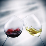 Glasses of red and white wine. Toasting royalty free stock photo