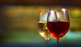 Glasses of red and white wine. Two glasses of red and white wine stock photo
