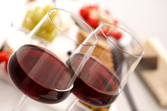 Glasses of red wine with appetiser