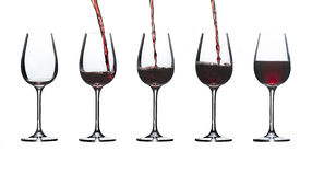 Glasses for red wine as they fill low to high Stock Image