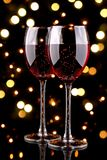 Glasses of red wine with bokeh light effect Stock Image