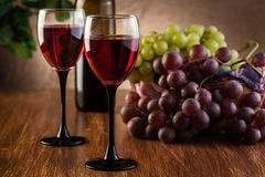 Glasses of red wine and bottle Stock Image