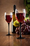 Glasses of red wine and bottle Stock Photos