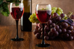 Glasses of red wine and bottle Stock Photography