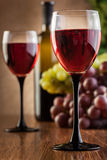 Glasses of red wine and bottle Stock Photo