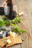 Glasses of red wine with cheese, crackers and grape Royalty Free Stock Photos