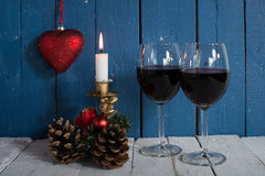 Glasses of red wine with Christmas decoration Stock Photos